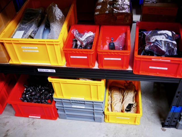 Carver One Parts in yellow and red storage boxes